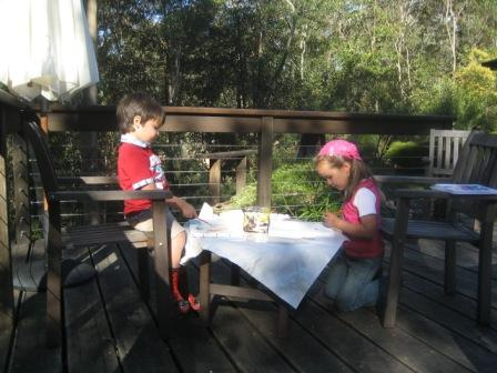 Nicole and Jorick making a painting on the veranda