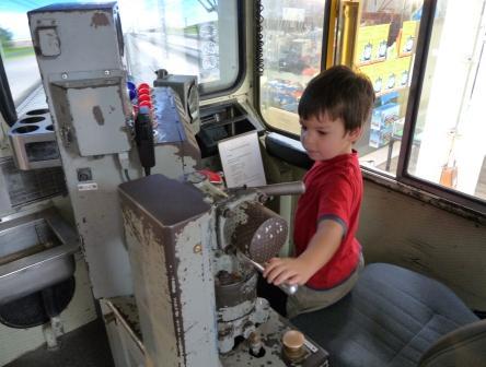 Jorick turning the brake behind a train simulator.