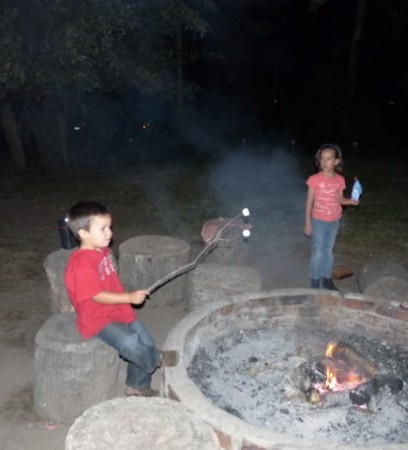 Keeping warm near the fire with marsh mellows.